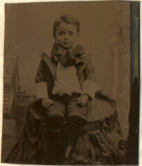 tintype of boy wearing a bow